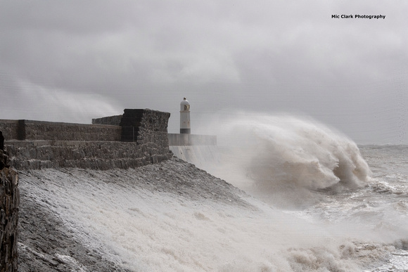 Stormy Seas Batter Porthcawl Pier and Lighthouse.